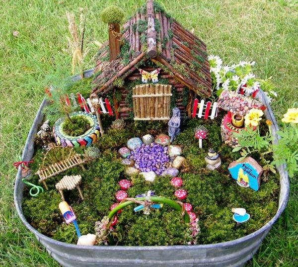 diy jardin de fée avec maison de bois et mousse végétale