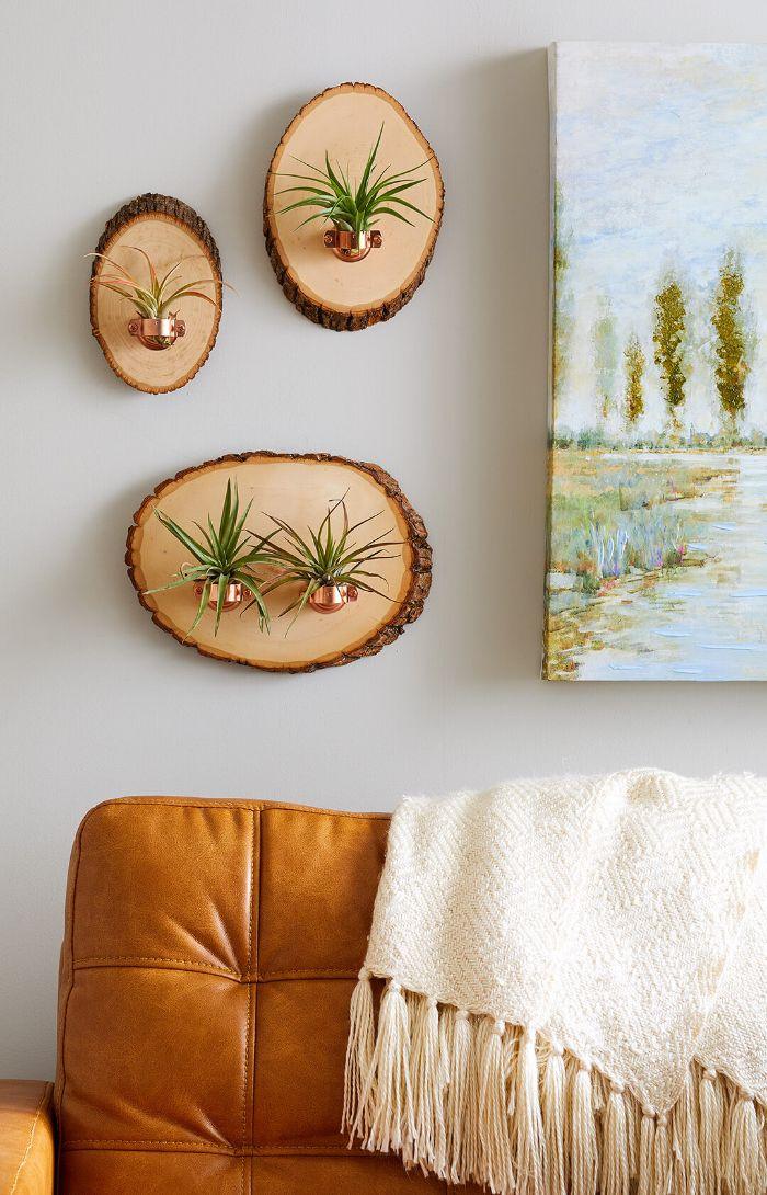 support pour pots de fleurs mural rondin de bois déco idées inspirantes pour créer une ambiance unique