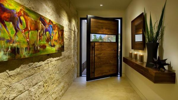 décoration d'entrée de maison mur en pierre
